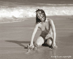 Girl on a Beach - Copyright Norm La Coe